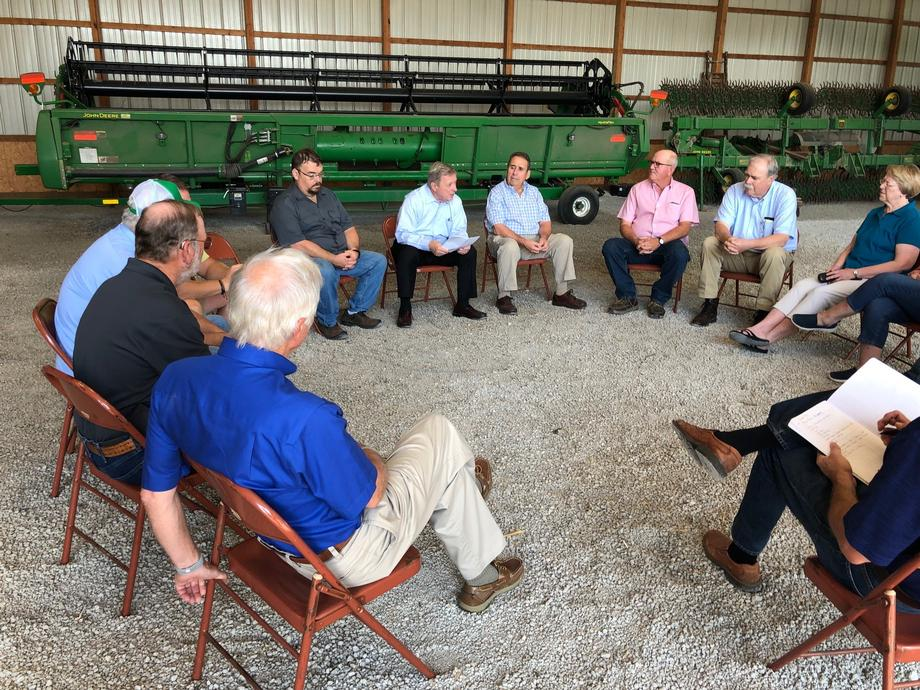Durbin participating in a roundtable discussion with local farmers to discuss agricultural issues